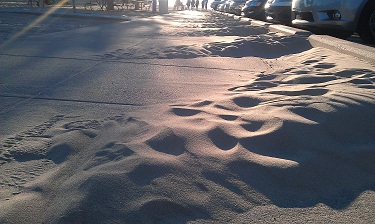 Sand over the sidewalk at Holland State Park