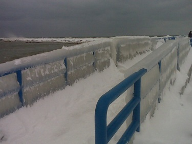 Holland State Park pier. Iced rails and snow covered.
