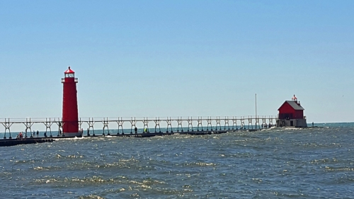 Grand Haven Lighthouse and pier viewed from North Shore Fisherman's Pier