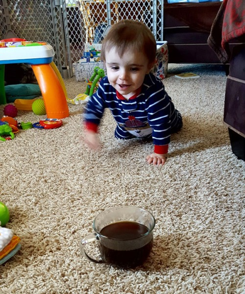 Son crawling towards the coffee