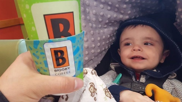Son smiling at the Biggby Coffee