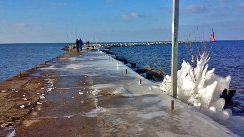 Out on the open iced over pier in Muskegon.
