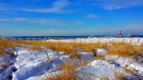 A sunny winter day along Lake Michigan, capturing St. Joseph's two lights