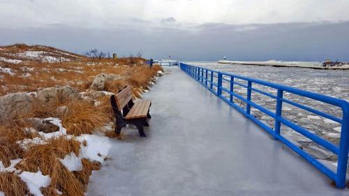 Icy pier alongside White River Light, Michigan