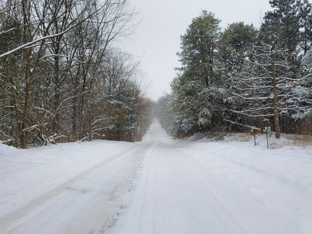 Out on the open dirt road, Brighton, Michigan, snow covered roads