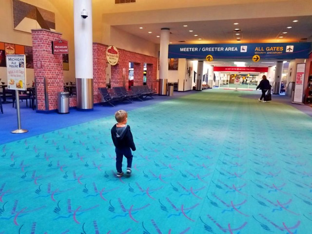 Family travel time! My little man experiencing his first airport and flight.