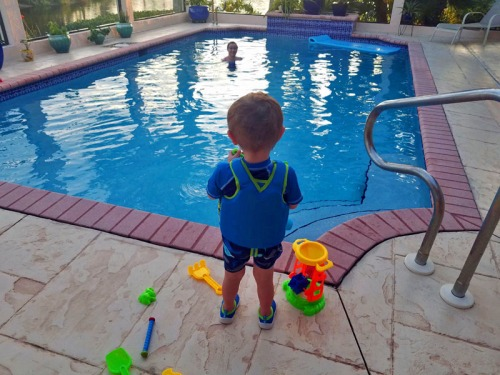 My little man and his first pool experience.